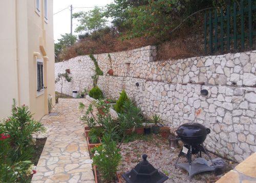 stone built garden with barbecue, bbq, at Natura Villas